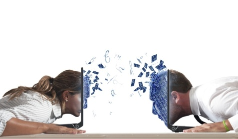 Concept of virtual love with boy and girl with laptop